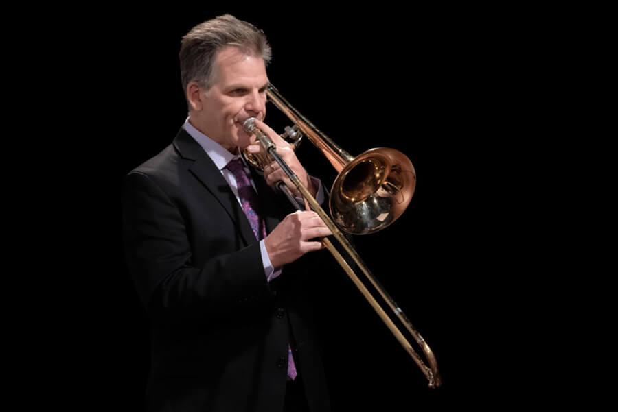 Photo of Michael Becker playing a trombone